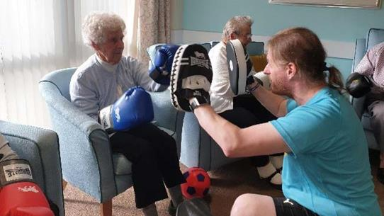 Queensridge Court Residents Enjoying Taking Part In A Boxing Session
