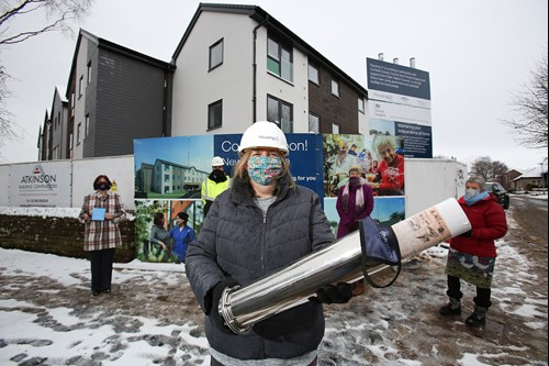 Standing outside of Newton House with the time capsule